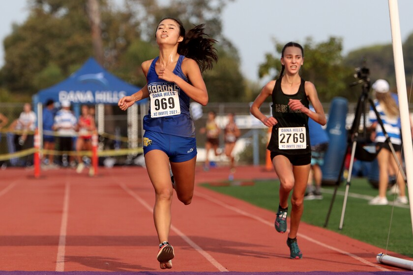 Fountain Valley senior Kaho Cichon (969) finishes third in the Division 1 girls' invitational race on Saturday.