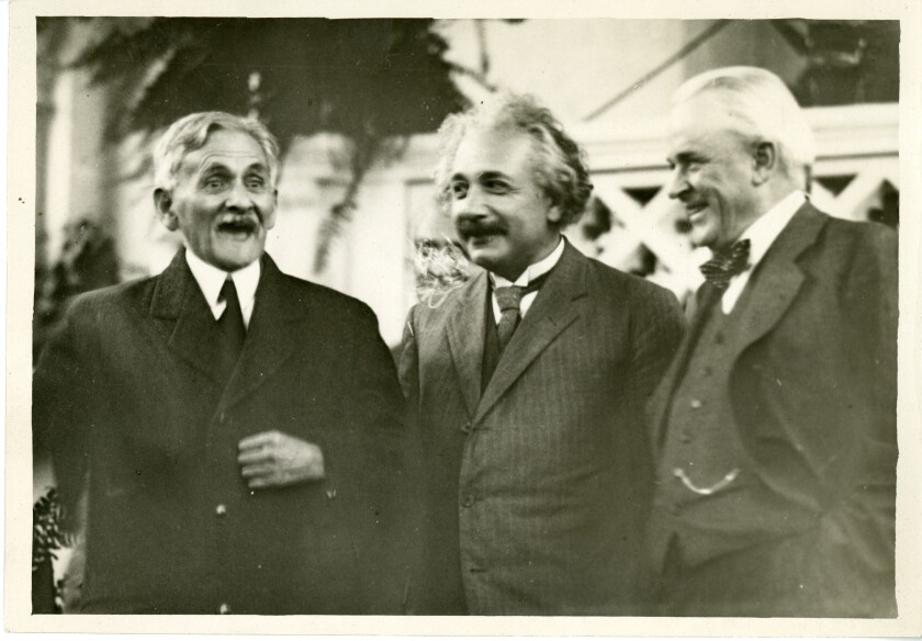 From left, physicists A.A. Michelson and Albert Einstein and former Caltech President Robert A. Millikan