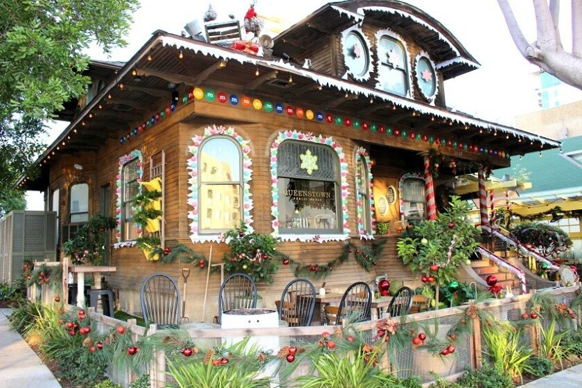 Queenstown Public House tunrs into a life-sized gingerbread house during the holidays.
