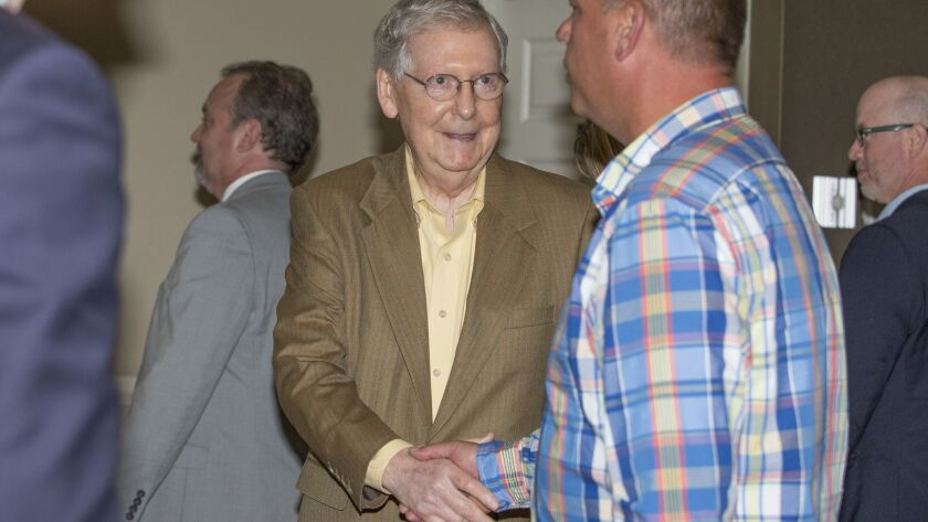 U.S. Senate Majority Leader Mitch McConnell greets attendees at a luncheon in Paducah, Ky., on Tuesday.