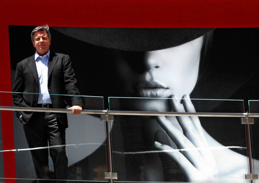 Bert Dezzutti, senior vice president of the western region for Brookfield Office Properties, which owns the Figat7th shopping center in downtown Los Angeles, pauses near the future home of Spanish fashion retailer Zara.