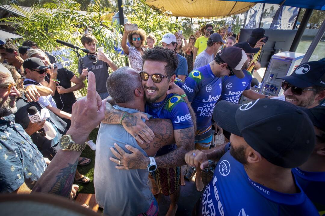 Ricardo Toledo hugs his son, Filipe Toledo of Brazil
