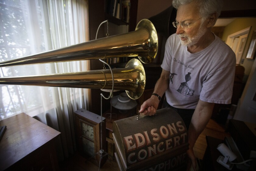 Wax cylinder collector John Levin looks at some of his holdings.