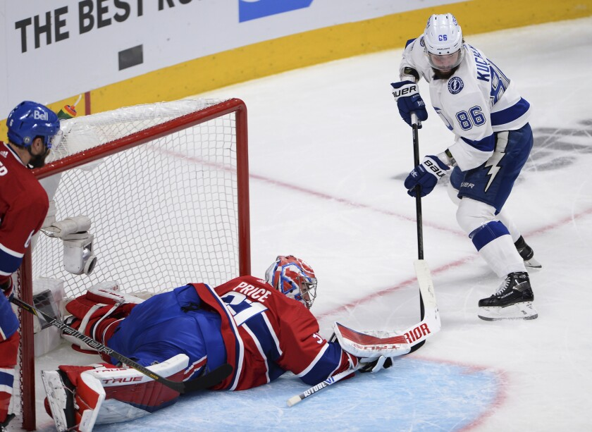Montreal Canadiens goaltender Carey Price (31) makes a save on Tampa Bay Lightning's Nikita Kucherov (86) during the second period of Game 3 of the NHL hockey Stanley Cup Final, Friday, July 2, 2021, in Montreal. (Ryan Remiorz/The Canadian Press via AP)