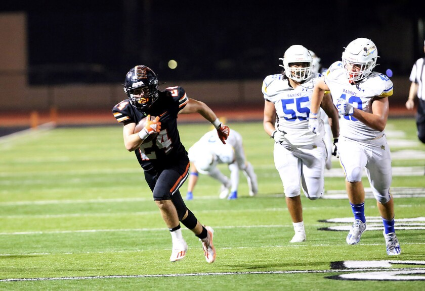 Huntington Beach's Evan Riederich (24) runs in for a touchdown in the fourth quarter on Friday.