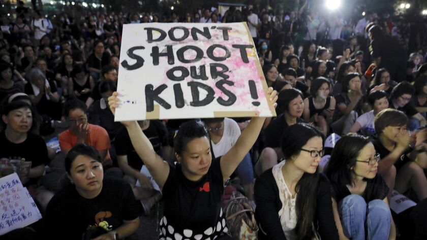 Hundreds of mothers protest against the amendments to the extradition law in Hong Kong on Friday, Ju