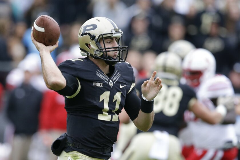 Purdue quarterback David Blough (11) throws against Nebraska during the first half of an NCAA college football game in West Lafayette, Ind., Saturday, Oct. 31, 2015. (AP Photo/Michael Conroy)