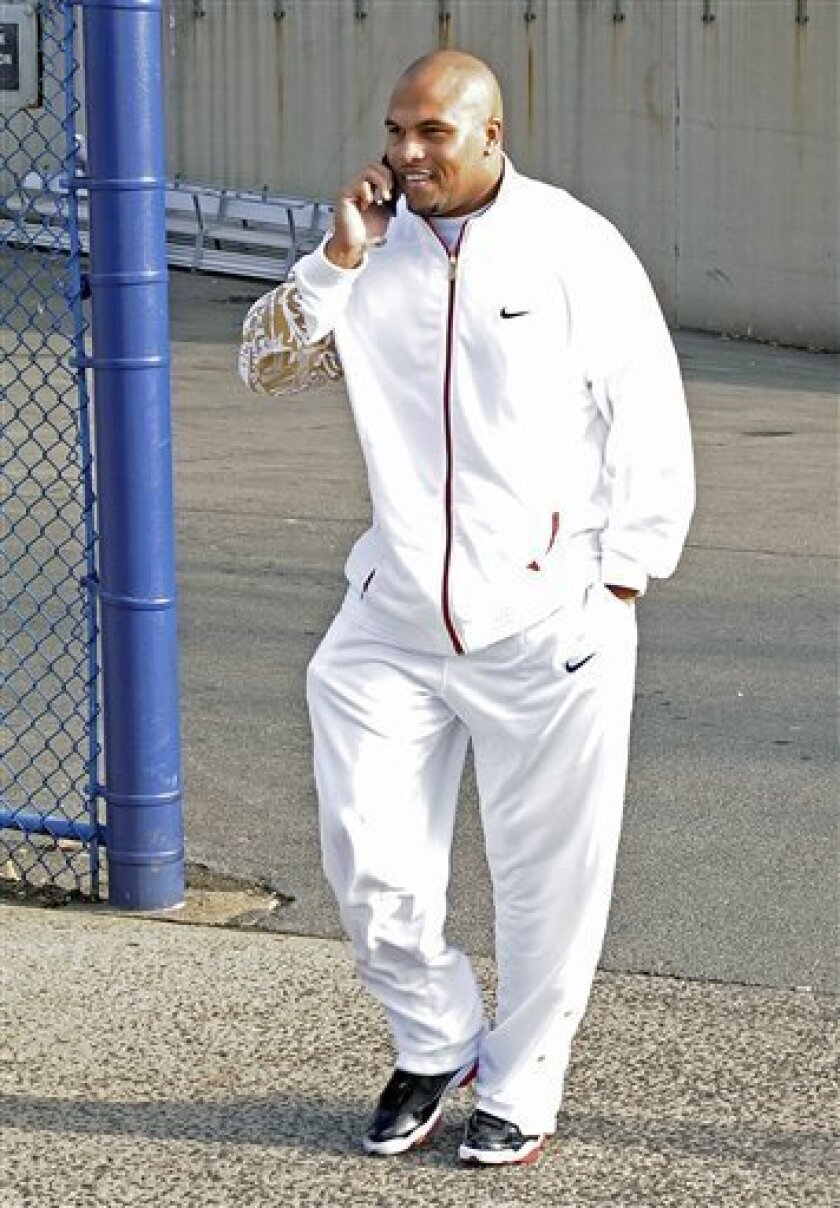 New York Giants' Antonio Pierce talks on his cell phone as he leaves Giants Stadium after practice for Sunday's NFL game against the Philadelphia Eagles Friday, Dec. 5, 2008 at in East Rutherford, N.J. (AP Photo/Bill Kostroun)