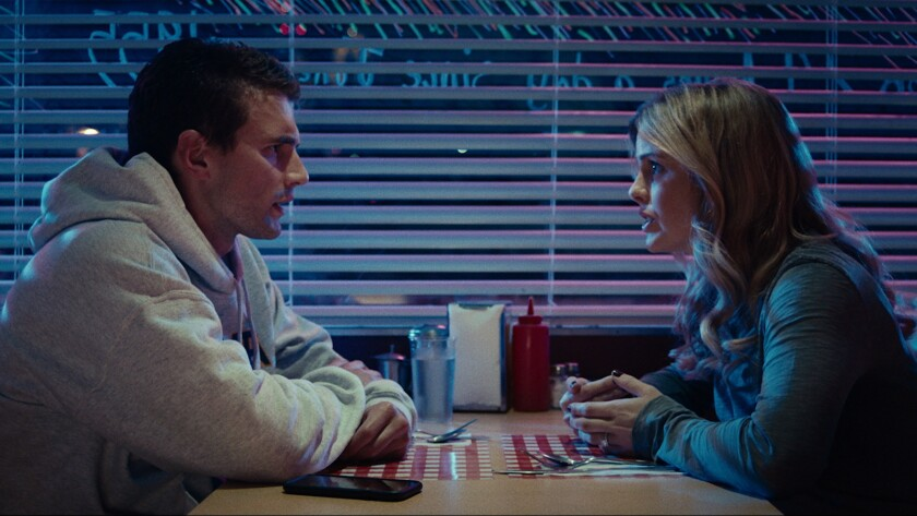"""(L-R) - Alex Russell and Rosie McLver in a scene from the movie """"Brampton's Own."""" Credit: Dark Star"""