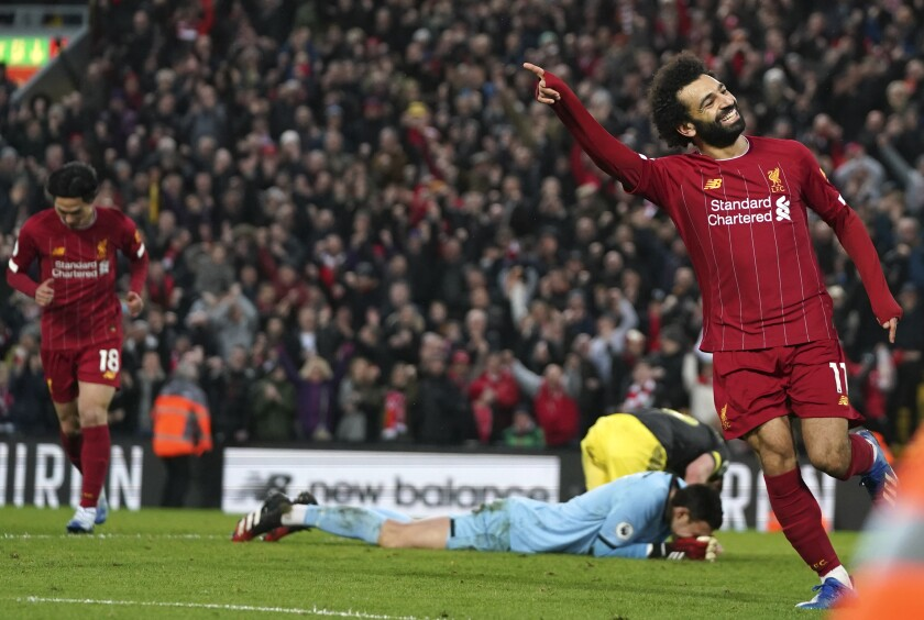 Liverpool's Mohamed Salah celebrates after scoring his sides fourth goal during the English Premier League soccer match between Liverpool and Southampton at Anfield Stadium, Liverpool, England, Saturday, February 1, 2020. (AP Photo/Jon Super)
