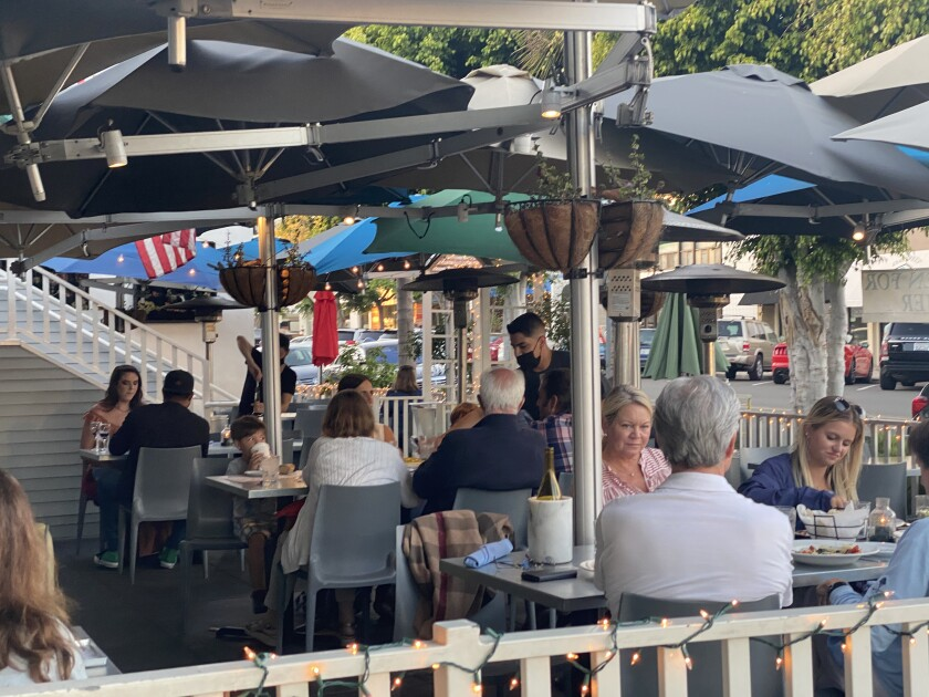 The Cottage restaurant on Fay Avenue in La Jolla will not increase tables to full capacity for several months.