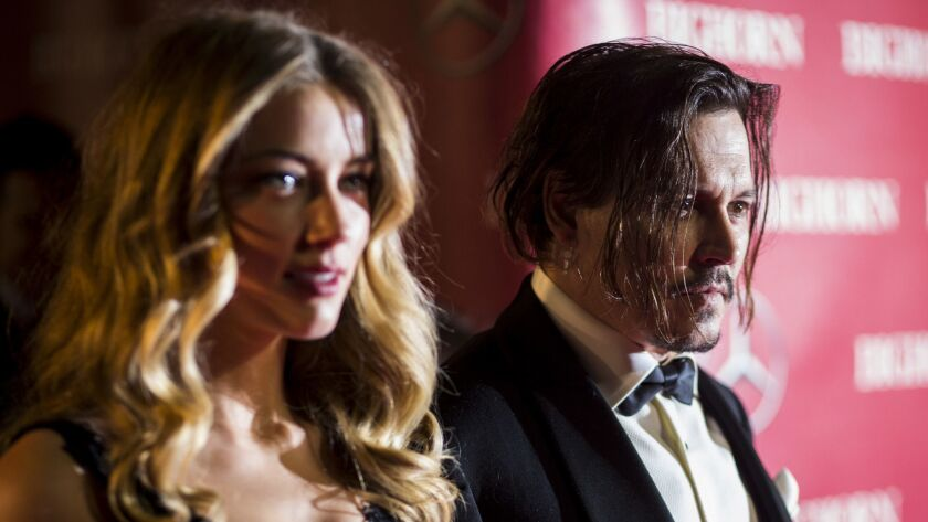 PALM SPRINGS, CA--JANUARY 02, 2016-- Actors Johnny Depp and Amber Heard arrive at the red carpet of