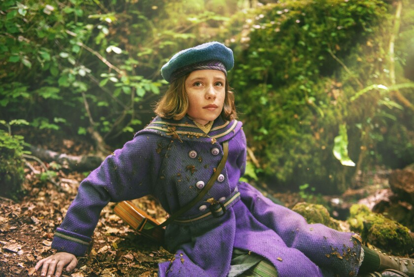 """This image released by STXfilms shows Dixie Egerickx in a scene from """"The Secret Garden."""" (STXfilms via AP)"""