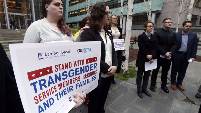 Plaintiffs Cathrine Schmid, second from left, and Conner Callahan, second from right, with supporters at a March 2018 news conference.