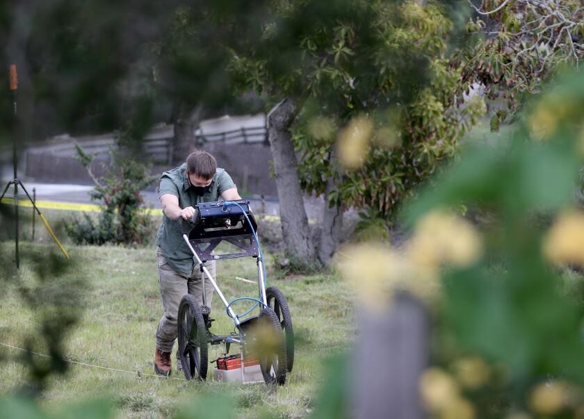 A San Luis Obispo County sheriff's deputy searches a hillside