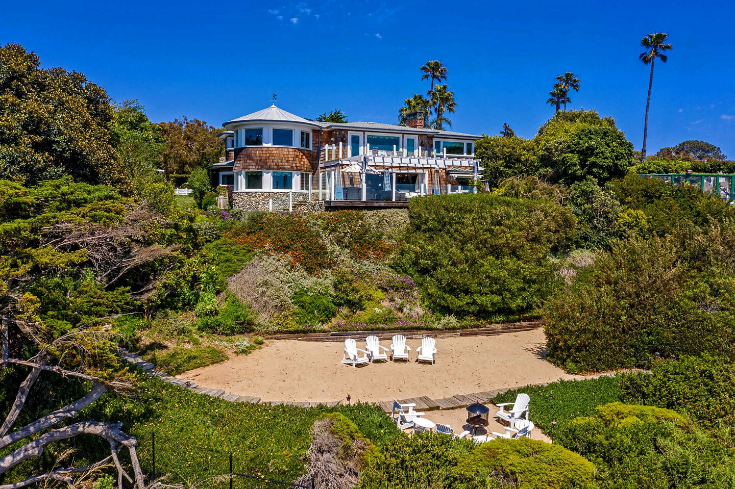 $17.5 million - Malibu Four of the five largest on-market deals in October came near the coast, including this Cape Cod that traded hands for $17.5 million on a bluff in Malibu's Point Dume.Records show the home was owned by Wendy Hughes, ex-wife of billionaire Public Storage founder B. Wayne Hughes. She paid $10.7 million for the property in 2012.The coastal compound spans an acre and includes a main house clad in wood shingles, guest cottage, swimming pool and multiple lawns dotted with fruit trees and flower-laden trellises. Scenic decks line the backside of the home, descending to a private sandy beach with gated access to the ocean below.Sandro Dazzan and Cooper Mount of the Agency held the listing. Ellen Francisco of Coldwell Banker Realty represented the buyer.