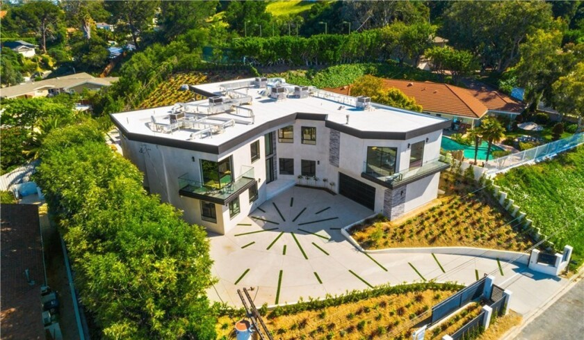 Recently rebuilt, the modern residence holds six bedrooms and nine bathrooms across 8,000 square feet.