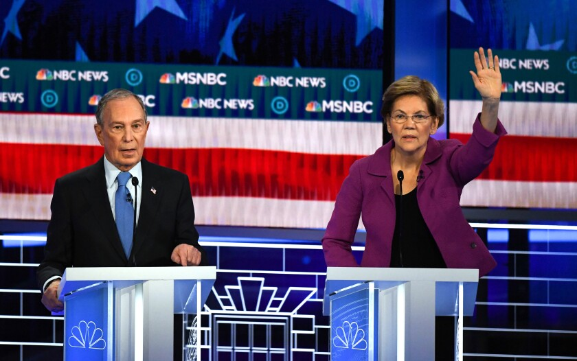 Democratic presidential hopefuls Former New York Mayor Mike Bloomberg and Massachusetts Senator Elizabeth Warren participate in the ninth Democratic primary debate of the 2020 presidential campaign season co-hosted by NBC News, MSNBC, Noticias Telemundo and The Nevada Independent at the Paris Theater in Las Vegas, Nevada, on February 19, 2020. (Photo by Mark RALSTON / AFP) (Photo by MARK RALSTON/AFP via Getty Images)