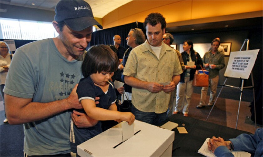 FAMILY MATTERS: Writer Greg Fields lets 3-year-old son Caelan cast his ballot at the Writers Guild of America Theater.