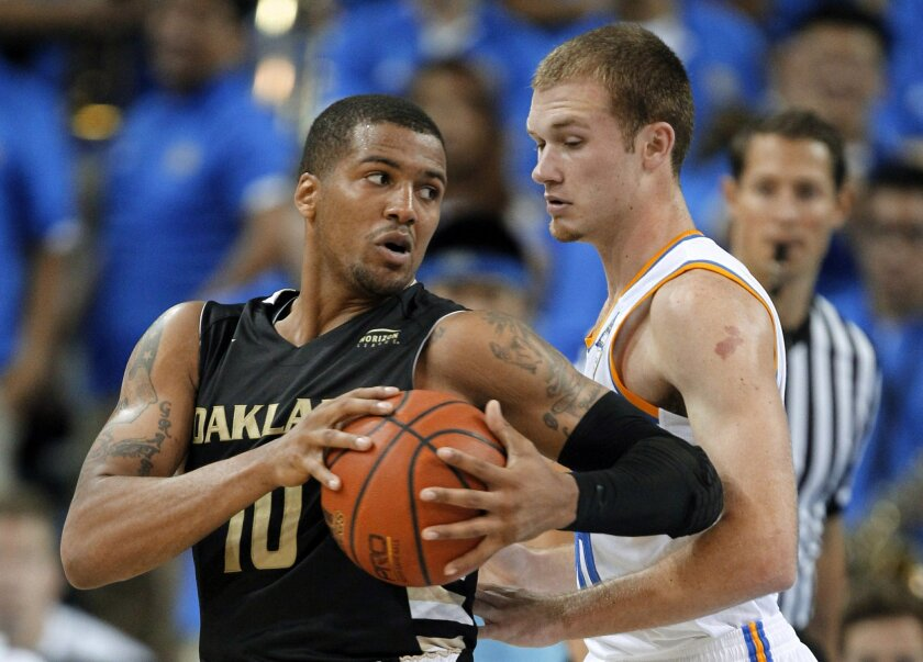 FILE- In a Nov. 12, 2013 file photo, Oakland guard Duke Mondy, left, takes the ball around UCLA guard Bryce Alford during the second half of an NCAA college basketball game in Los Angeles. Mondy is among the nation's leaders in steals, reviving a college career that once seemed headed off the rails. (AP Photo/Alex Gallardo, File)
