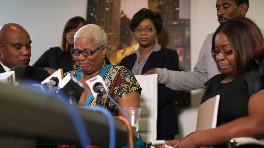 Sandra Bland's sisters hold a news conference in Chicago on Thursday. Her oldest sister, Shante Needham, is shown at center. At right is Sierra Cole, and in back, from left, are Shavon Bland and Sharon Cooper. Also shown is their attorney, Cannon Lambert, left, and their uncle, Paul Needham, back right.