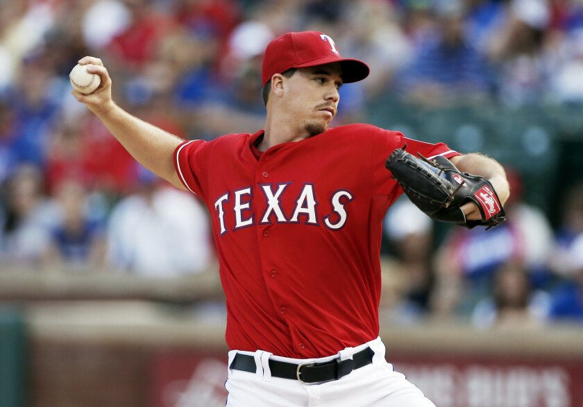 Texas Rangers starting pitcher Chi Chi Gonzalez throws during the first inning of a baseball game against the Boston Red Sox, Saturday, May 30, 2015, in Arlington, Texas. (AP Photo/Brandon Wade)
