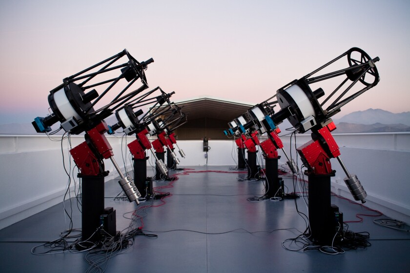 The MEarth-South telescope array, located on Cerro Tololo in Chile, searches for planets by monitoring the brightness of nearby, small stars.