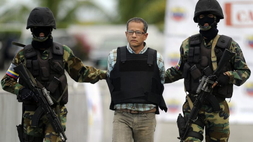 Colombian drug trafficker Jorge Cifuentes is taken into custody in 2012.