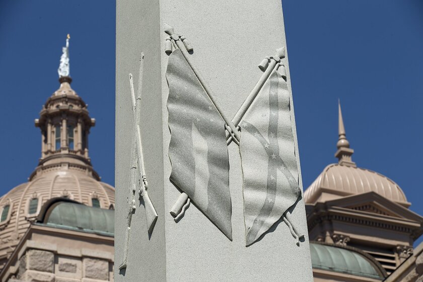 A Civil War memorial on the east grounds of the state Capitol in Austin, Texas, depicts Confederate flags. New school textbooks in the state are being criticized for minimizing the roles of slavery in the Civil War and segregation in the Jim Crow-era South.