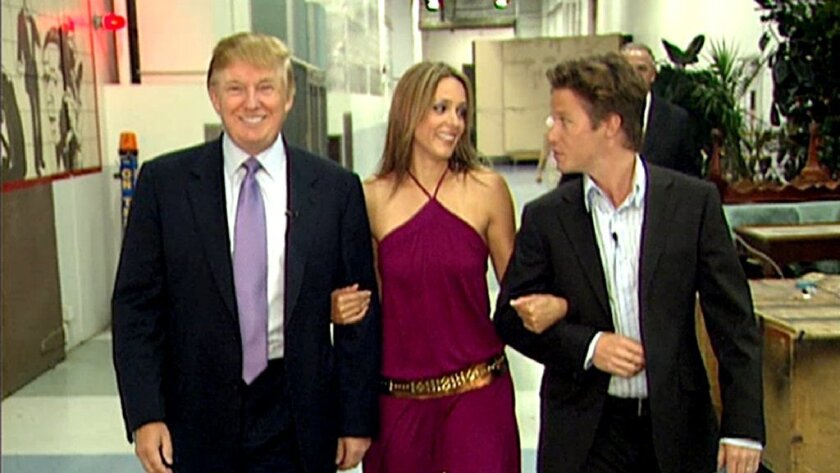 "In this 2005 frame from video, Donald Trump prepares for an appearance on ""Days of Our Lives"" with actress Arianne Zucker (center). He is accompanied to the set by Access Hollywood host Billy Bush."