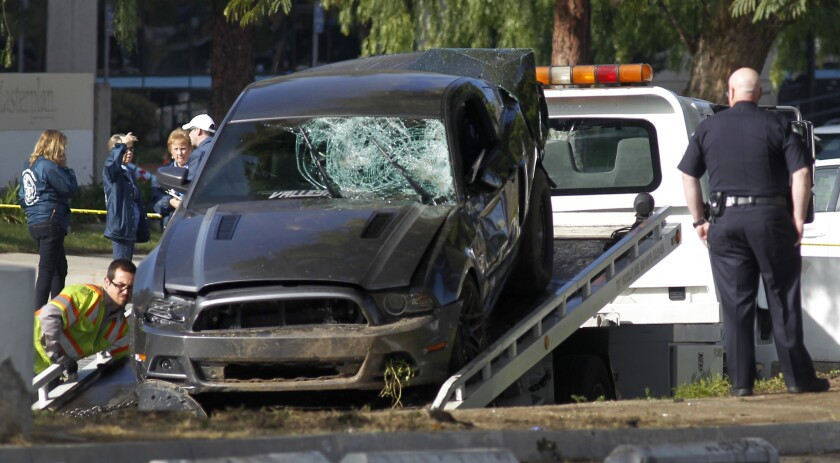 The Ford Mustang that struck three pedestrians, killing two of them, in Chatsworth is removed.