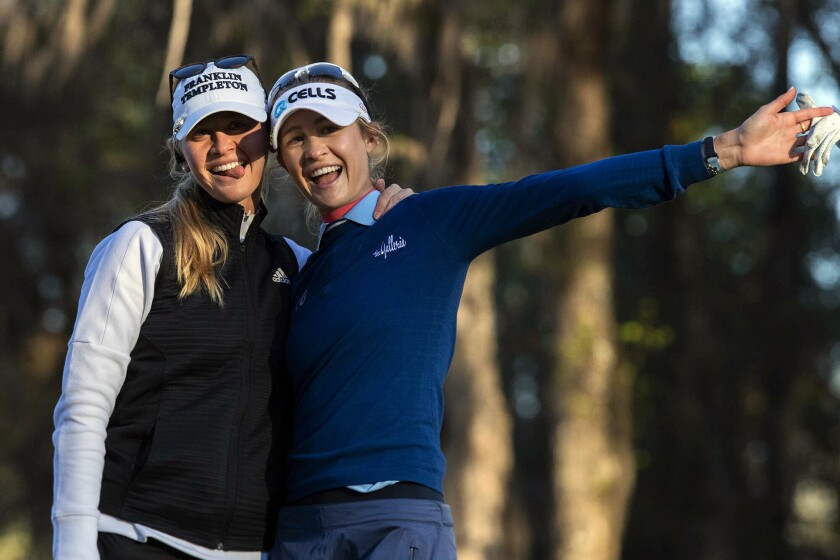 Sisters Jessica Korda, left, and Nelly Korda ham it up before the start of the first round for the LPGA golf tournament at Golden in Ocala Golf and Equestrian Club, Thursday, March 4, 2021, in Ocala, Fla. (Cyndi Chambers/in Ocala Star-Banner via AP)