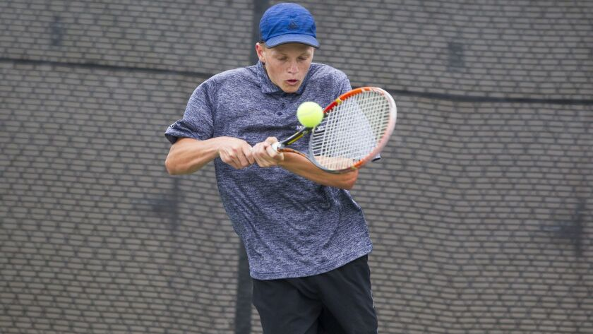 San Marcos' Thomas Foulger hits a backhand while playing against Olympian's Jorge Castaneda in the Division II finals.