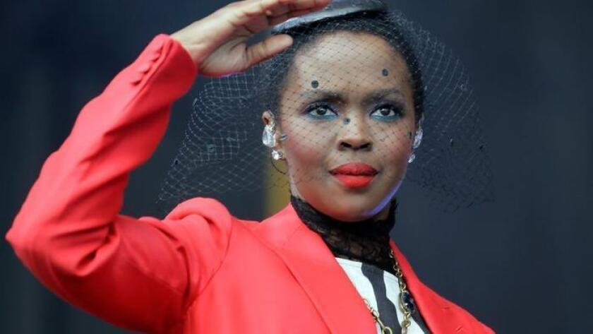 In this April 29, 2016 file photo, Lauryn Hill and her band perform at Congo Square during the New Orleans Jazz and Heritage Festival at the Fair Grounds in New Orleans. (/ The Associated Press)