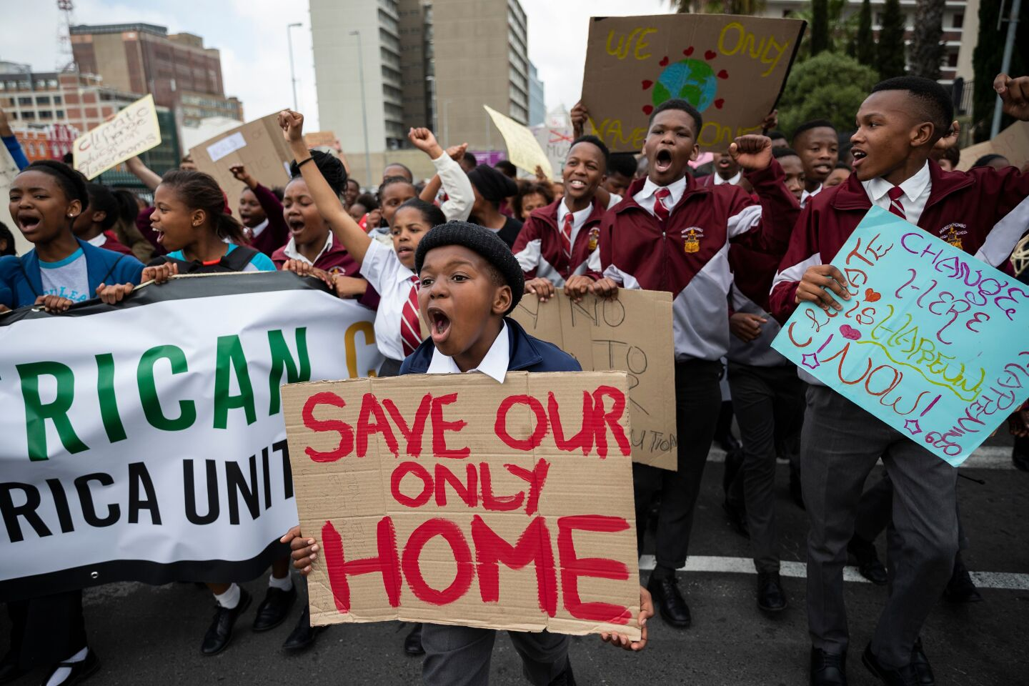 Mandatory Credit: Photo by NIC BOTHMA/EPA-EFE/REX (10419322d) Protesters take part in the Global Climate Strike as they march to parliament in Cape Town, South Africa, 20 September 2019. Thousands of children across South Africa joined the global call to action and climate strike protesting in Cape Town calling on government to make radical change in tackling climate change as millions of people around the world are taking part in protests demanding action on climate issues. Cape Town Global Climate Strike, South Africa - 20 Sep 2019 ** Usable by LA, CT and MoD ONLY **