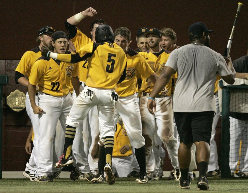 Kennesaw State's Cornell Nixon, number 5, celebrates after scoring against Georgia Southern in the eleventh inning of an NCAA regional college baseball game on Saturday, May 31, 2014, in Tallahassee, Fla. Kennesaw State won the game 13-5. (AP Photo/Steve Cannon)