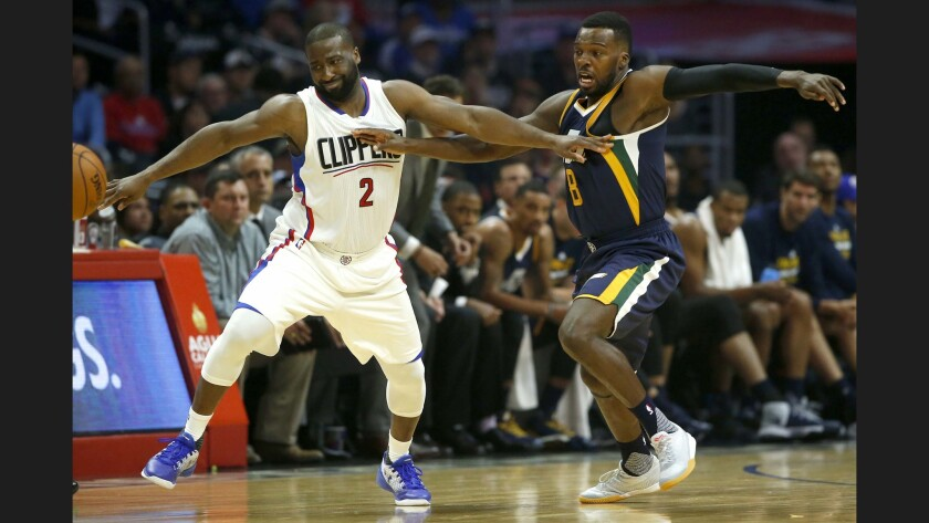Clippers guard Raymond Felton loses control of his dribble while being defended by Jazz guard Shelvin Mack.