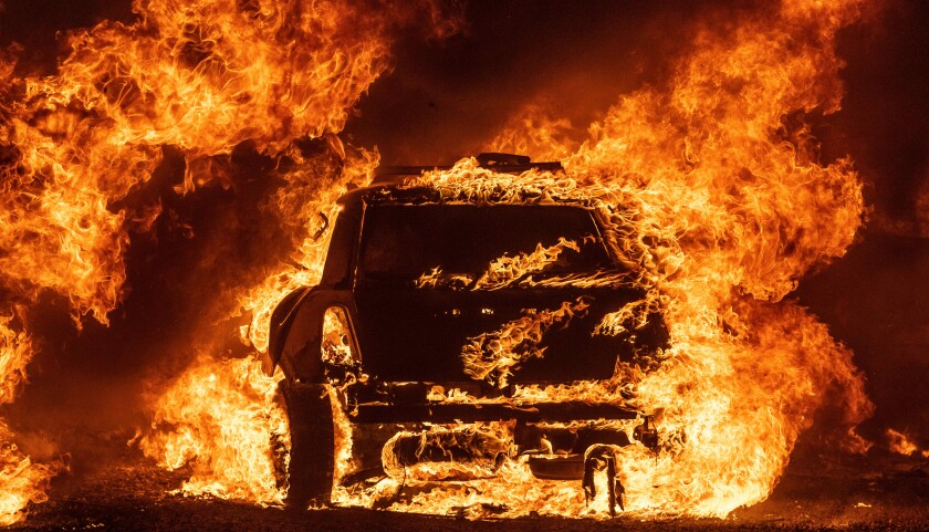 A car burns while parked at a residence in Vacaville, California during the LNU Lightning Complex fire on August 19, 2020. -