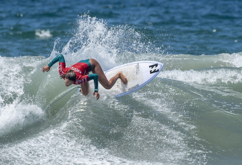 Luana Silva rides a wave during the women?s open semifinals of the National Scholastic Surfing Assn.