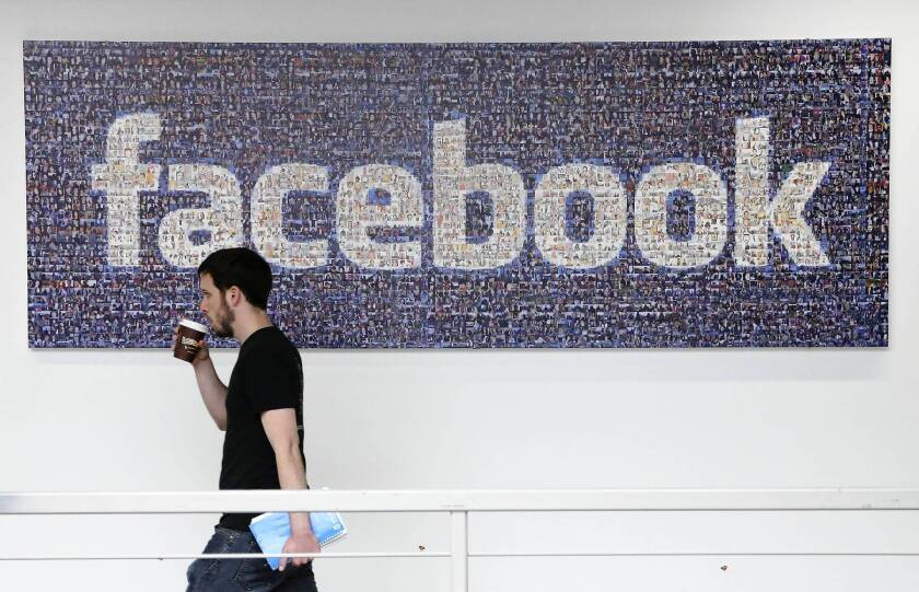"As part of Facebook's changes to its privacy policy, teens can now let people ""follow"" them on Facebook and see posts that are made public, similar to Twitter. Above, a Facebook employee at its headquarters in Menlo Park, Calif."