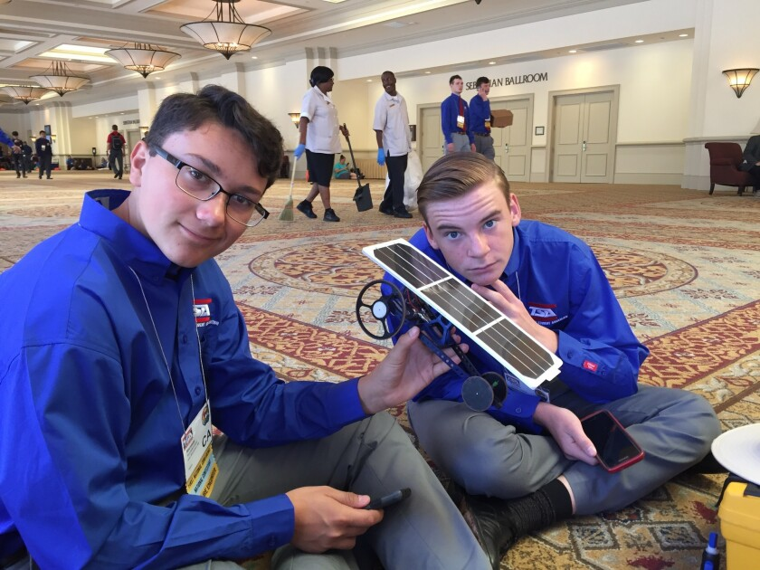 "Alpine students Ramses Lara (left) and Hayden Loarie with their national champion ""Dan II"" solar spr"