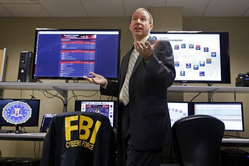 FBI Supervisory Special Agent J. Keith Mularski, who heads the cybercrime squad at the agency's Pittsburgh field office, displays a screen shot from the Darkode website on July 14.