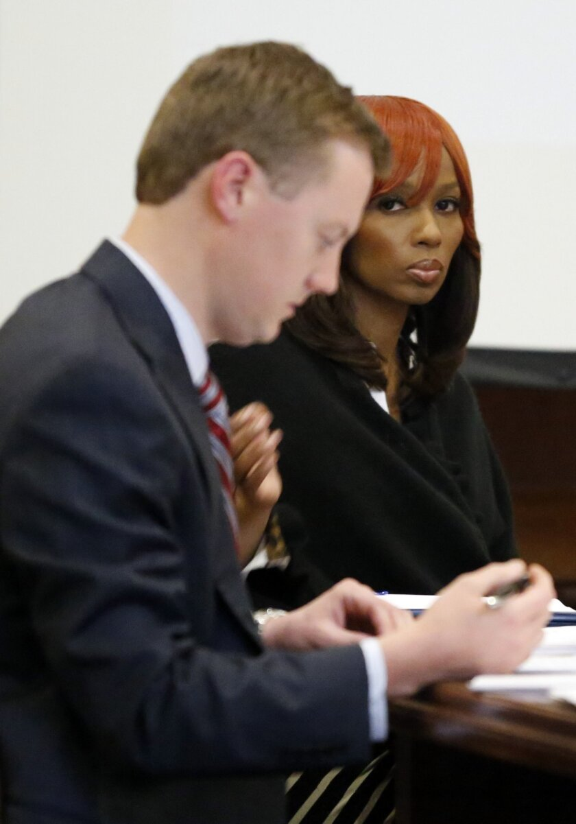 Natasha Stewart, also known as Pebbelz Da Model, looks toward reporters while Jared Tomlinson, one of her attorneys, works on jury instructions in county court in Jackson, Miss., Friday, Jan. 31, 2014. Stewart is charged with depraved-heart murder in the death of 37-year-old Karima Gordon, of Atlan