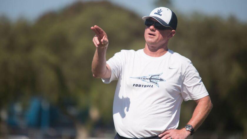 Corona del Mar football coach Dan O'Shea directs the defense during a recent practice. The Sea Kings