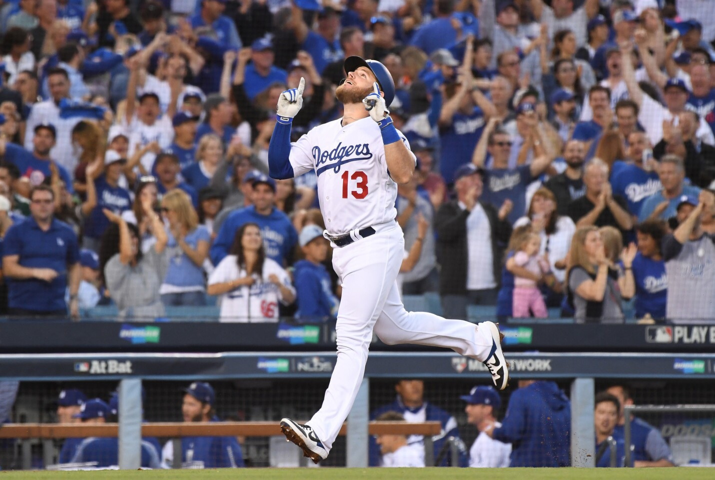 LOS ANGELES, OCTOBER 4, 2018-Dodgers Max Muncy celebrates his three-run home run against the Braves in the 2nd inning in Game 1 of the NLDS at Dodger Stadium Thursday. (Wally Skalij/Los Angeles Times)