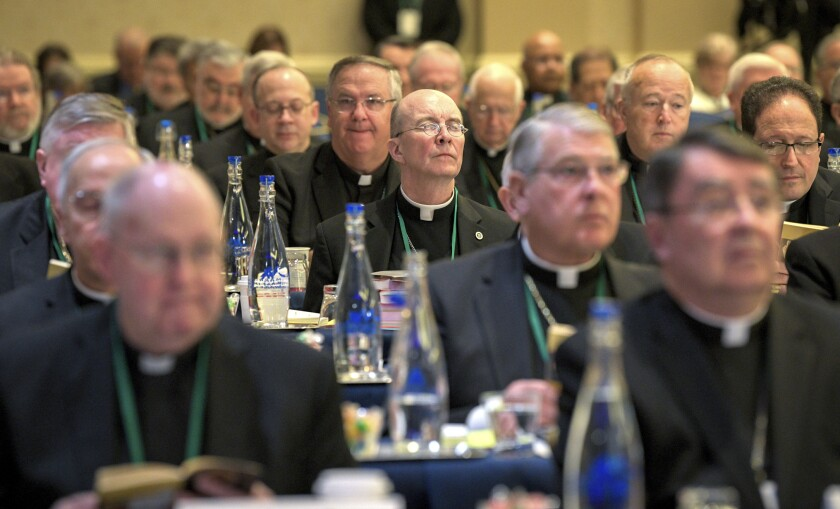 Bishops are seated during the opening moments of the United States Conference of Catholic Bishops Fall General Assembly at the Baltimore Marriott Waterfront Monday, Nov. 11, 2019. (Jerry Jackson/The Baltimore Sun via AP)