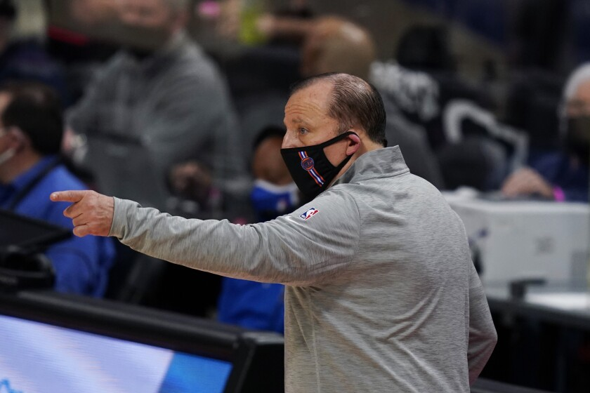 New York Knicks coach Tom Thibodeau gestures during the second half of the team's preseason NBA basketball game against the Detroit Pistons, Friday, Dec. 11, 2020, in Detroit. (AP Photo/Carlos Osorio)