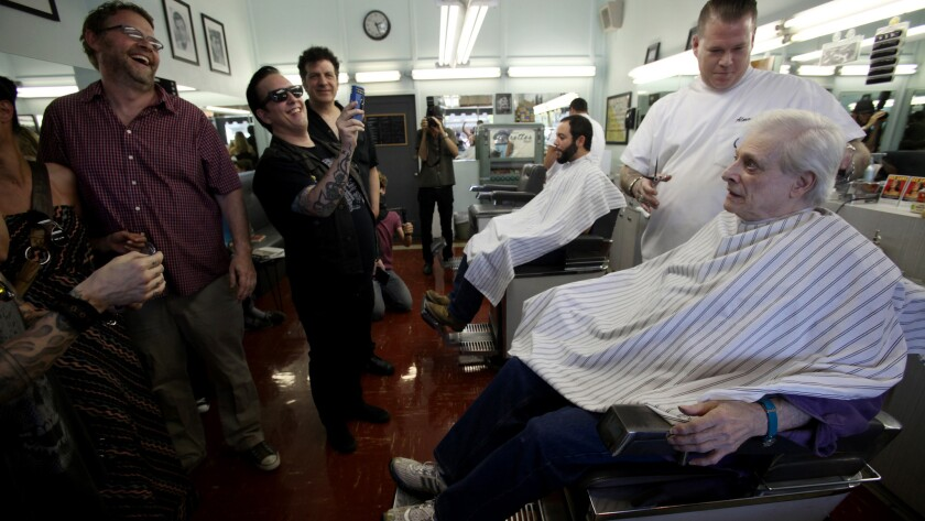 Harlan Ellison gets a haircut as fans watch before a 2013 book signing. The writer is recovering from a stroke he had last week.