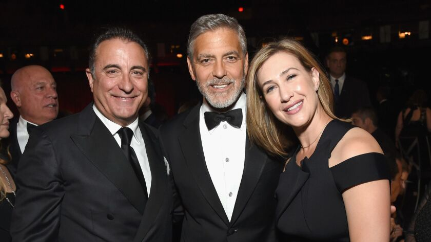 Andy Garcia, left, George Clooney and Paramount Television President Amy Powell attend the American Film Institute's 46th Life Achievement Award Gala Tribute to Clooney at Dolby Theatre on June 7 in Hollywood.