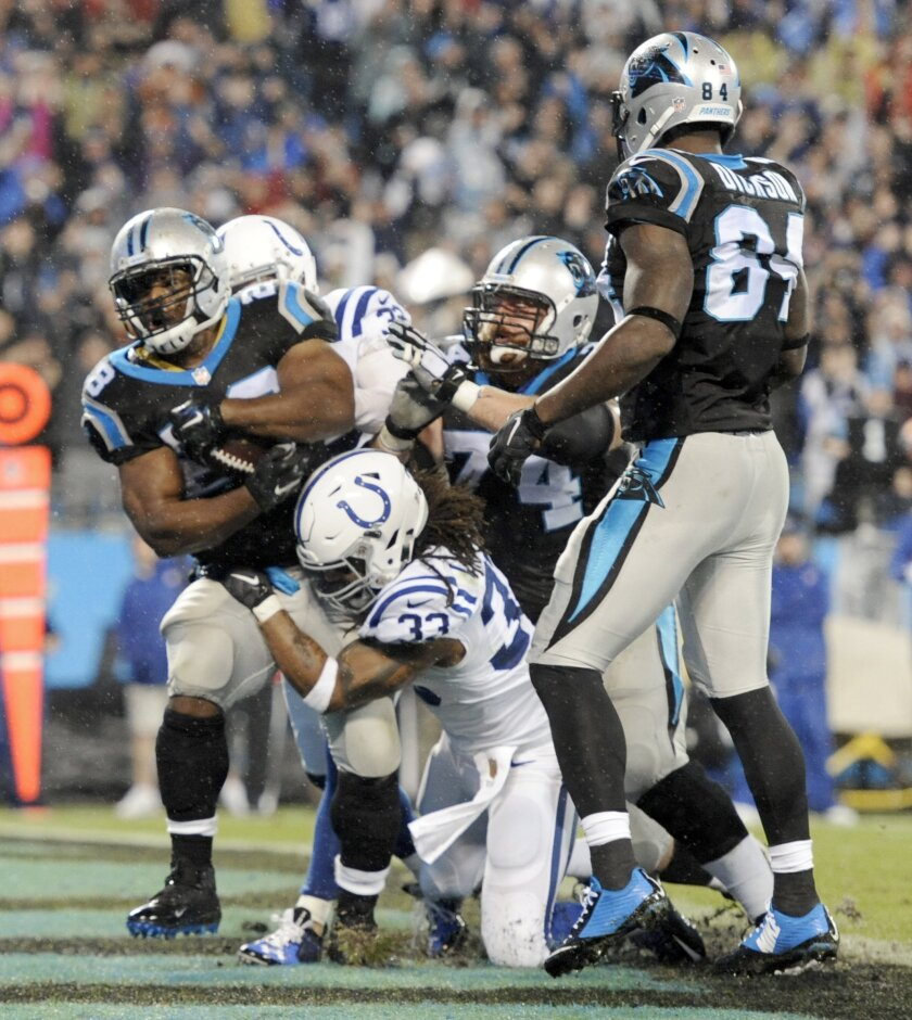 Carolina Panthers' Jonathan Stewart (28) runs into the end zone for a touchdown as Indianapolis Colts' Dwight Lowery (33) defends in the first half of an NFL football game in Charlotte, N.C., Monday, Nov. 2, 2015. (AP Photo/Mike McCarn)